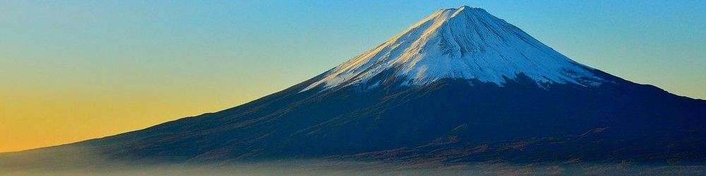 Volcano with snow cap. Japan